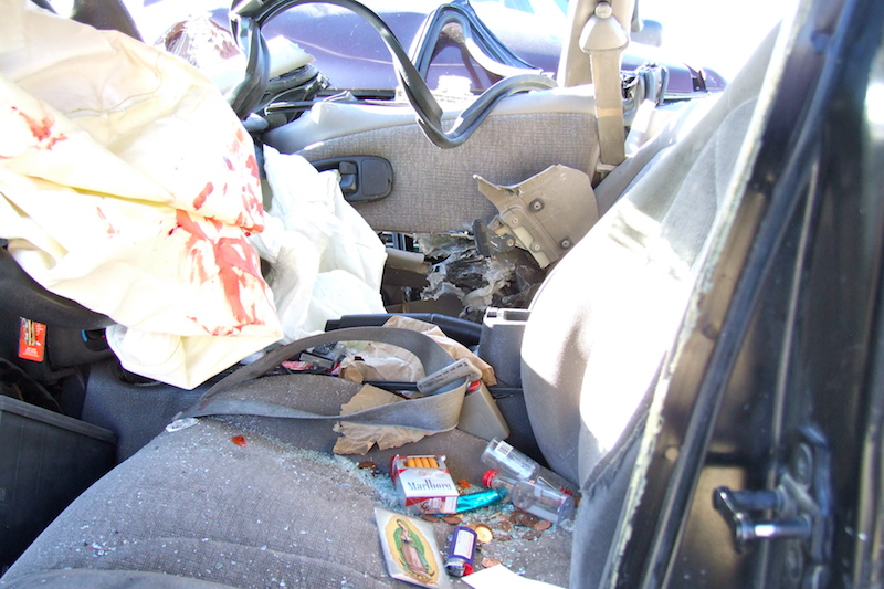 Image of inside of a car after a drunk driver hit it.