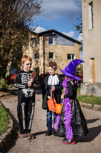 trick-or-treating kids dressed up for halloween