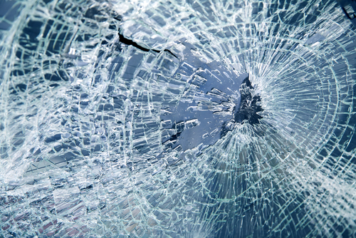 shattered windshield after Denver auto accident