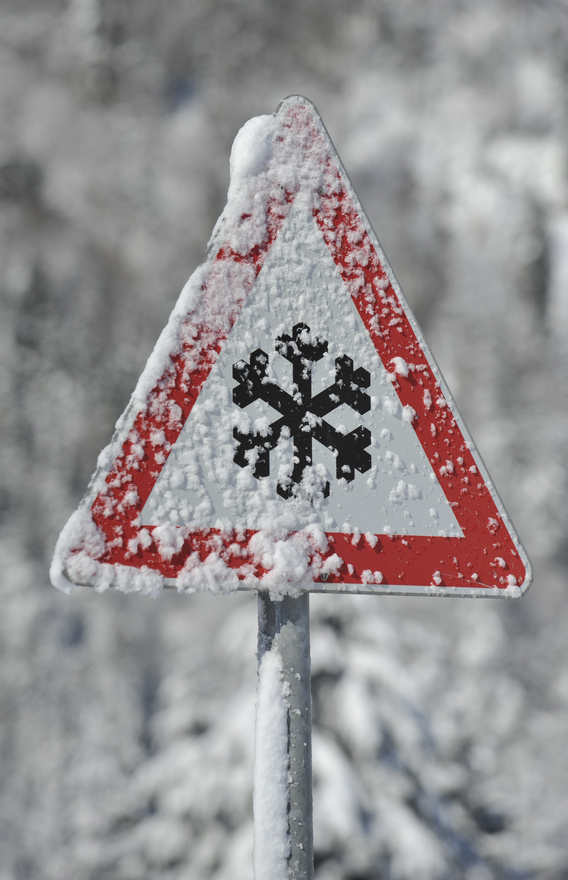 snow coverevd snow caution road sign